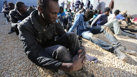 Illegal migrants caught at the coast of Souq al Jum'aa region in Tripoli, Libya, March 2015. Total of 97 migrants from Senegal, Mali, Cameroon, Nigeria and Liberia [Image credit: Mail & Guaridan, from Mustafa Bag/Anadolu Agency/Getty Images]